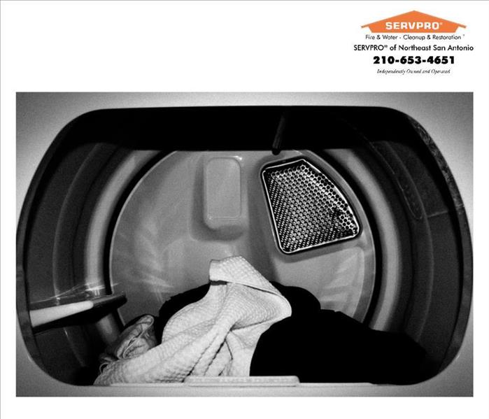 Black and white dryer SERVPRO logo and info top corner